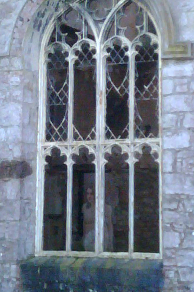 A terrifying photo of a ghostly young woman in the castle has emerged...