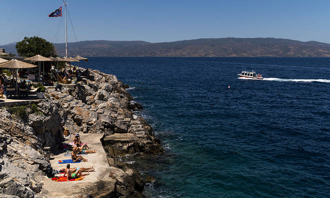 Greece's coronavirus cases are increasing as people travel to the islands