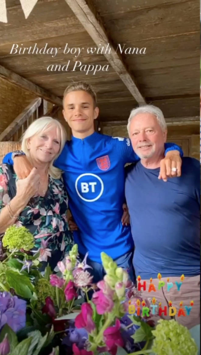 Brooklyn posed with his grandparents during the gathering