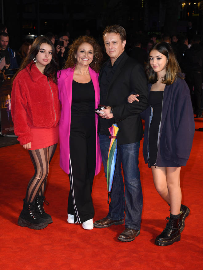 Nadia and husband Mark Adderley with their daughters