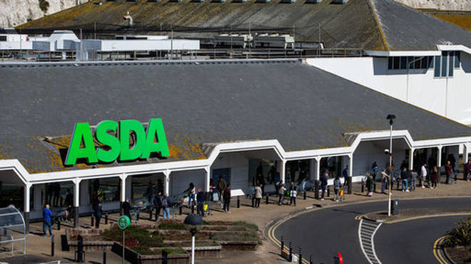 Asda shoppers queueing outside a store