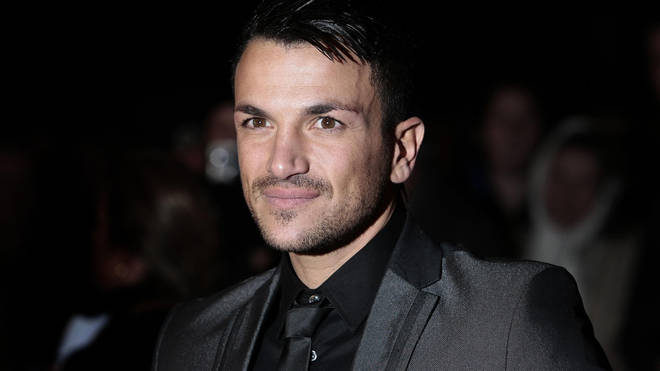 Peter Andre wears smart black suit on the red carpet as he announces tour