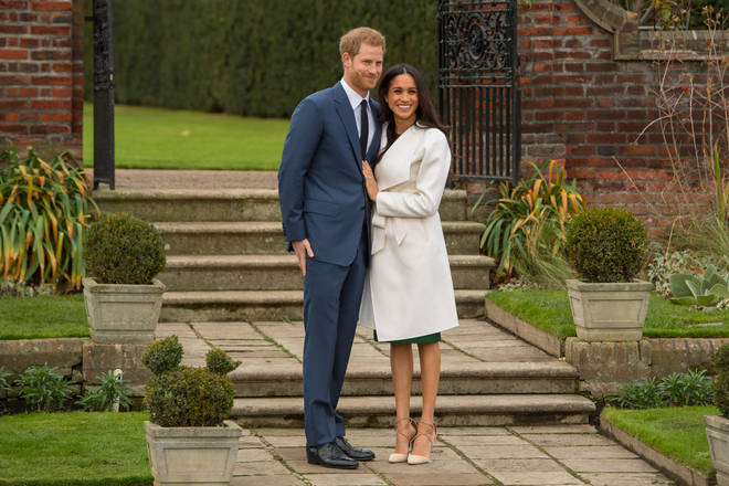 Meghan and Harry posted for engagement pictures in the Sunken Garden