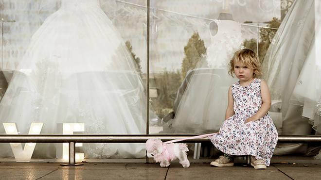Child waiting outside shop