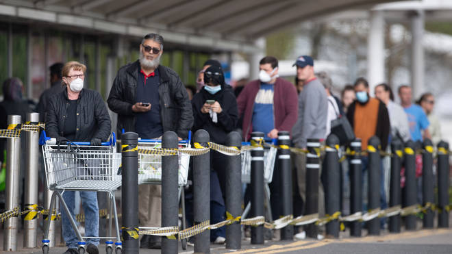 Customers queuing outside Tesco