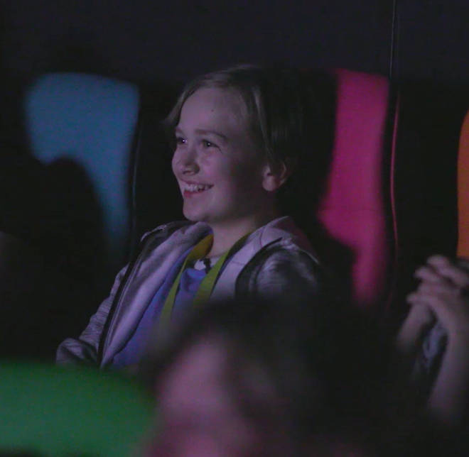 Darach beams as he watches a film at the Glasgow MediCinema