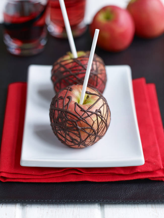 These chocolate apples are a tasty twist on a toffee apple