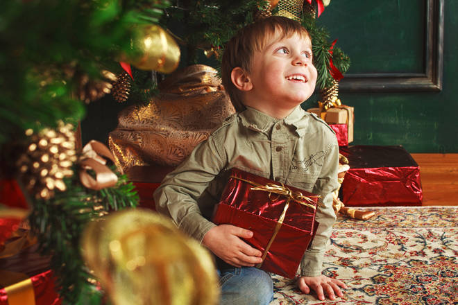 Many kids can't resist a peep at their Christmas tree presents before the big day... (stock image)