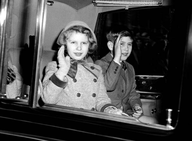 Prince Charles and Princess Anne on the way to Sandringham in the 50s