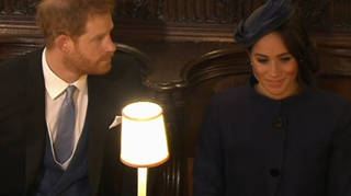 Prince Harry and Meghan Markle take their seats in St George's Chapel