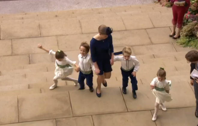 The bridesmaids and page boys were almost blown away on the steps