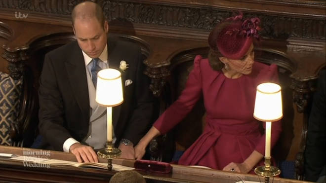 Prince William and Kate Middleton hold hands at the royal wedding