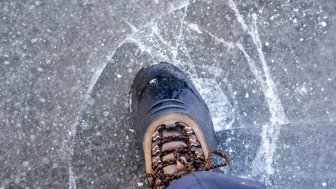 The woman warned people you can easily slip on the ice caused by de-icing cars with water