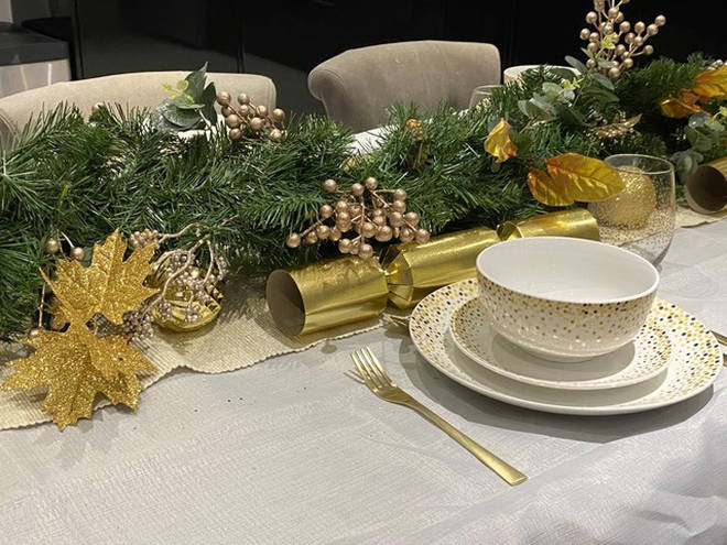 Fia opted for gold and green hues for her Christmas table