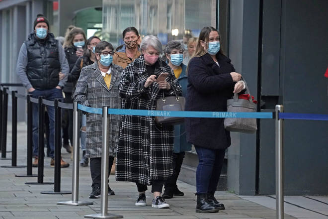 Shoppers queue outside Primark in Newcastle this morning