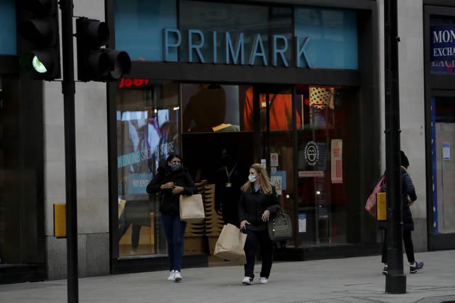 Two people leaving Primark on Oxford Street, London