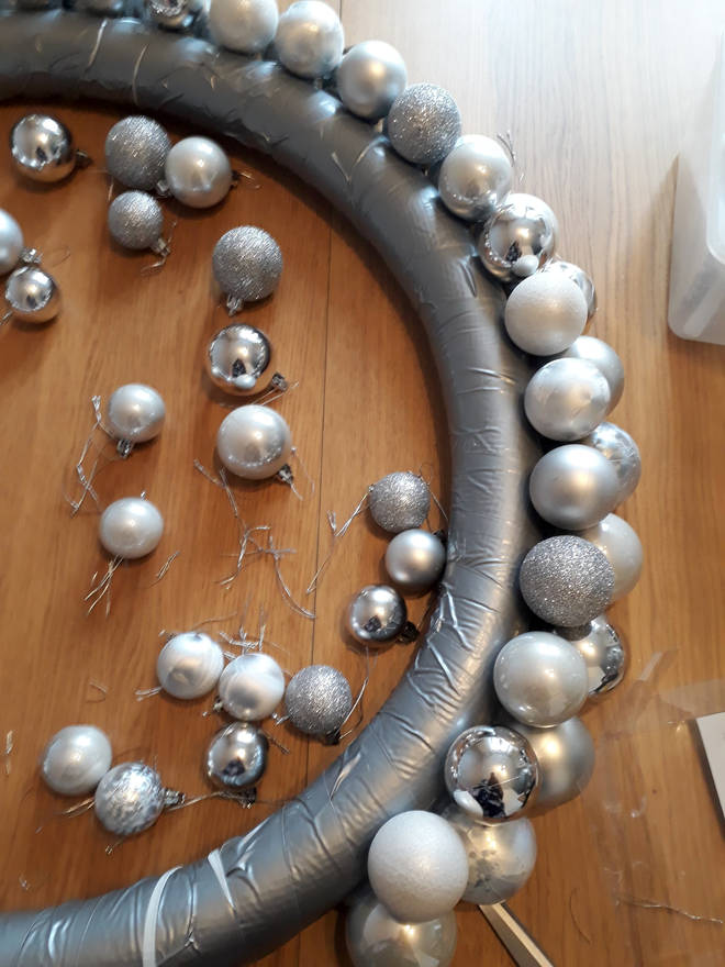 Use smaller baubles to fill any gaps and make it look full