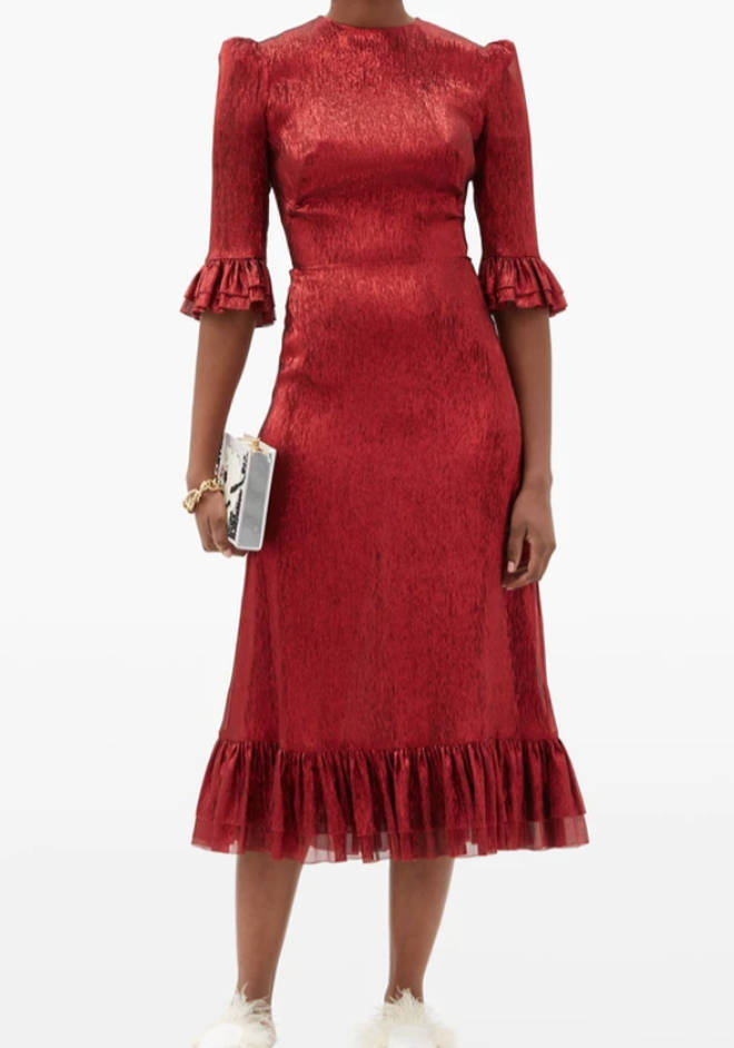 The dress is a rented piece by The Vampire's Wife from Hurr