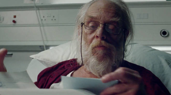 Santa can be seen writing Christmas letters at his hospital bed