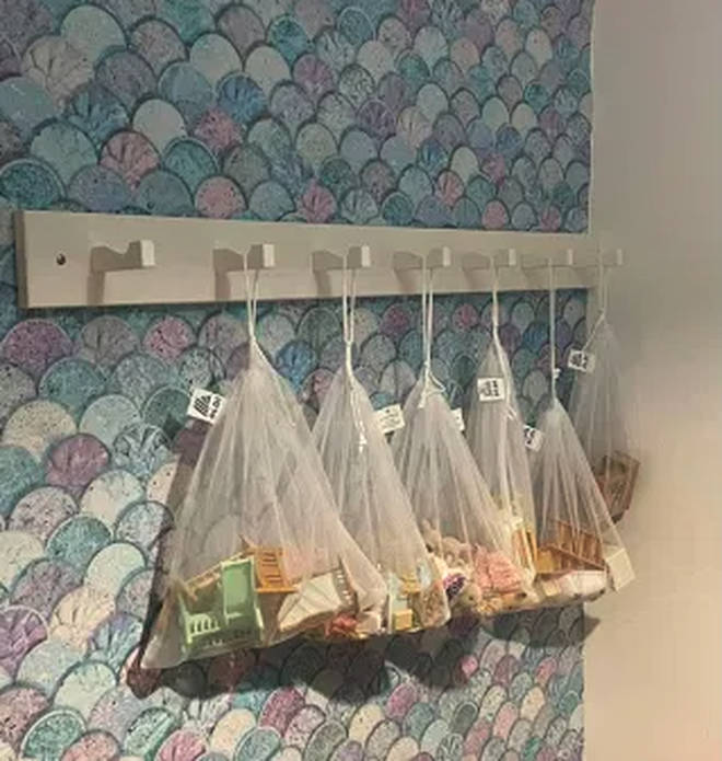 The mum used mesh bags from Aldi to hang the toys up