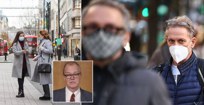 Brits have been told they may have to wear face masks until next winter
