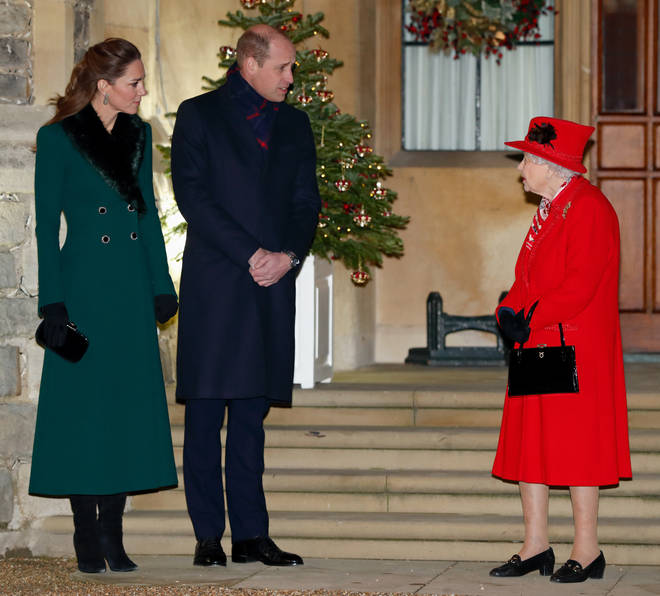 The Queen and the Cambridges remained socially distanced as they chatted