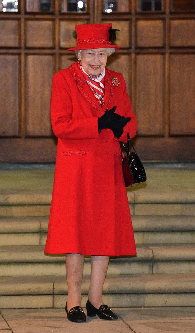 The Queen looked chipper in her 'Christmas Red' ensemble