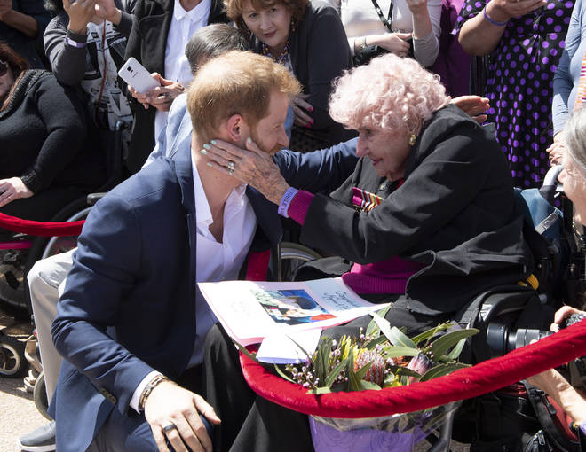 Prince Harry embraces his 92-year-old fan