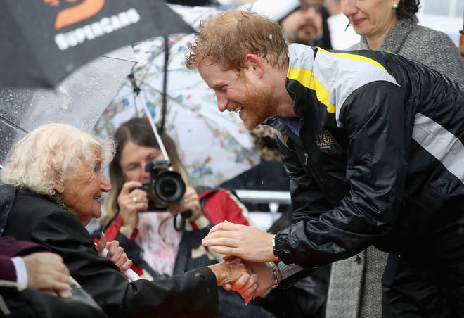Daphne braved the rain in 2017 for a cuddle with Prince Harry