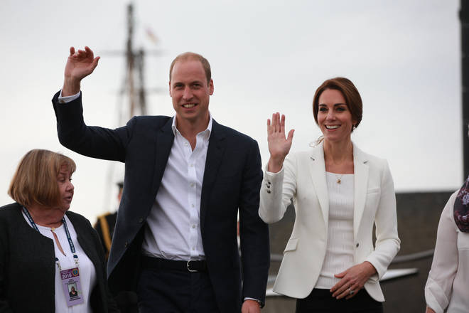 Kate Middleton and Prince William wave on a royal tour