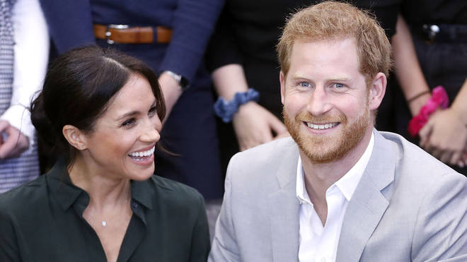 Meghan Markle smiles at Prince Harry during royal outing