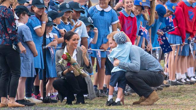 The Duke of Sussex hugs boy as he and Meghan Markle make royal tour to Australia