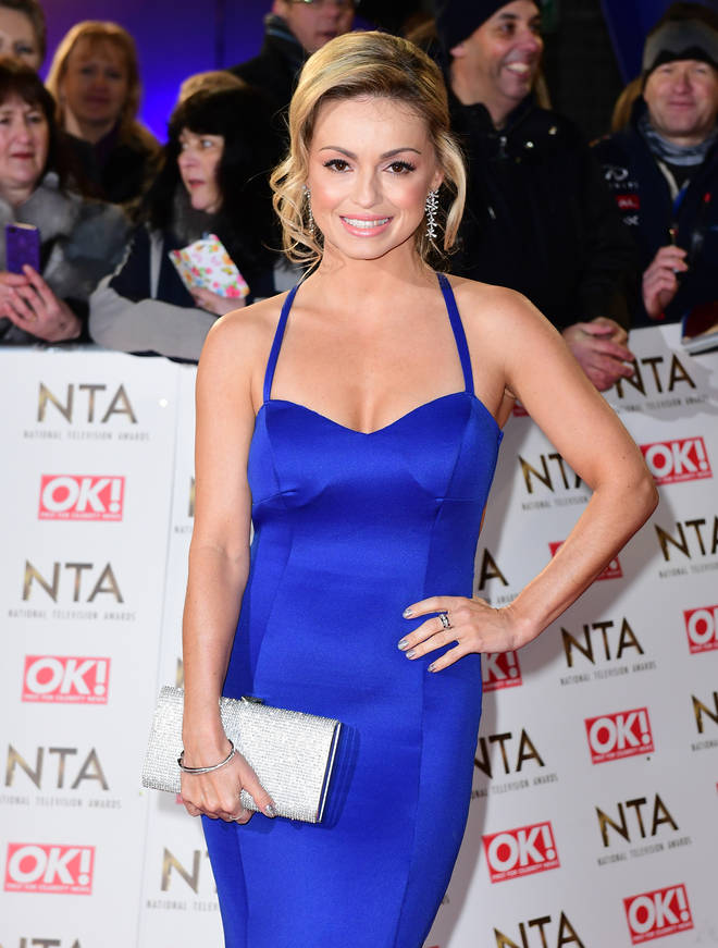 Ola Jordan wears a blue gown on the red carpet