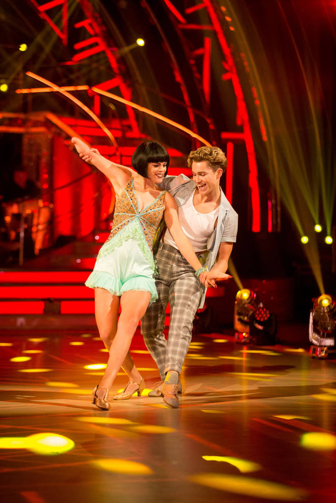 Lauren Steadman dances with AJ Pritchard in a green dress and short black wig