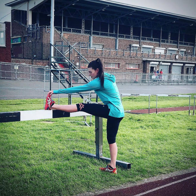 Lauren Steadman stretches her muscles on the athletics track