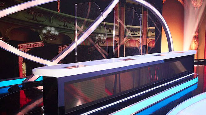 There are perspex screens between the Dancing On Ice judges