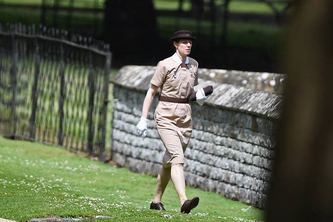 Maria Barrallo pictured at work with the royal family wearing her distinctive Norland uniform