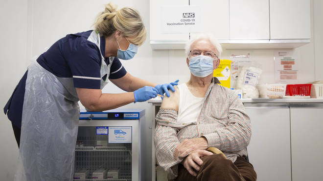 Peter Cast, 87, from Ashtead, receives the vaccine at Superdrug in Guildford