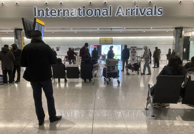 Passengers were pictured arriving to Heathrow before the travel restrictions came into force