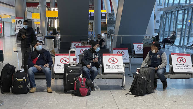Travellers seen waiting at Heathrow airport