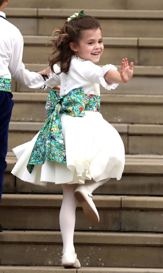 Teddy Williams waves to the crowds as she climbs the steps of St George's Chapel, Windsor