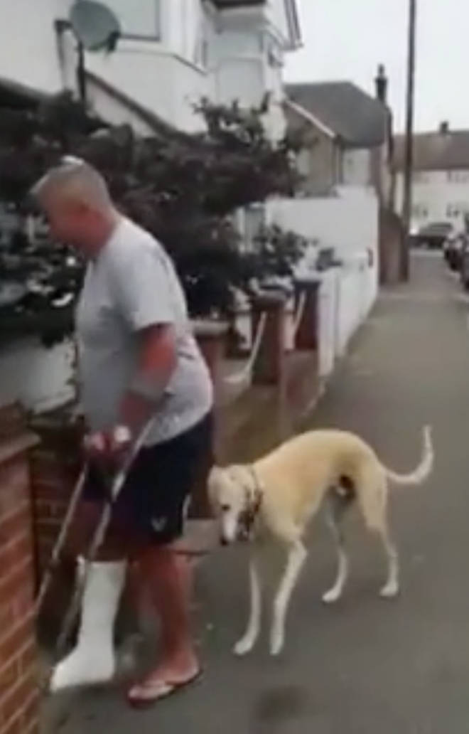 Billy can be seen limping next to his owner, who had broken his ankle