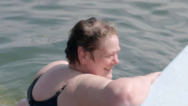 Anne Hegerty is seen taking a drip in the ocean in the clip