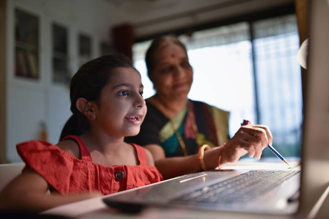 Homeschooling is a new role for parents, and it's not easy when there's a shortage of tech (file photo)