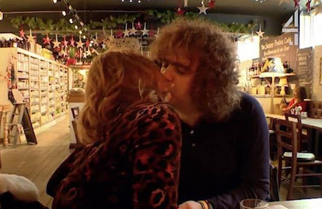 Daniel Wakeford and Lily have a kiss in a restaurant
