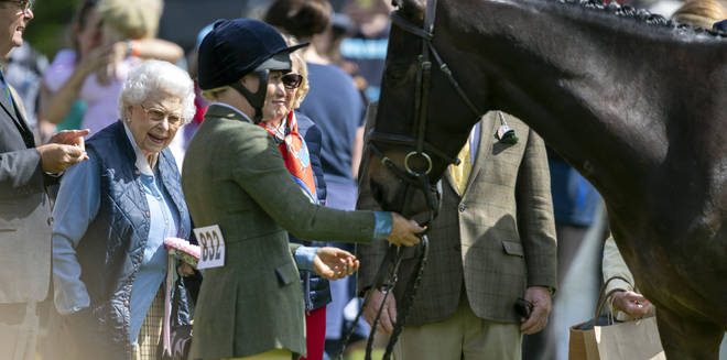 The Queen meets one of her racehorses at Windsor Castle in May 2018