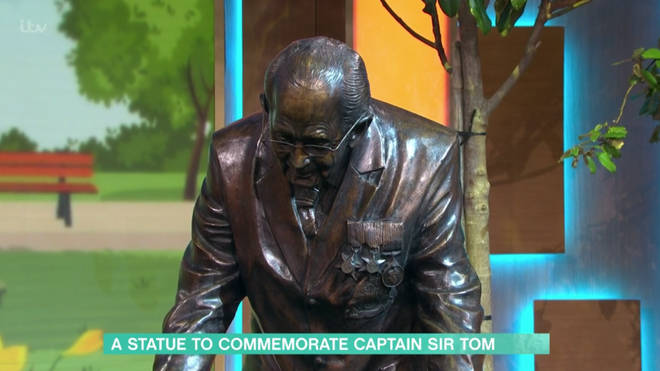 The bronze statue is life-size and shows Sir Tom walking laps of his garden