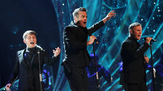 Robbie Williams on stage with Take That in 2011