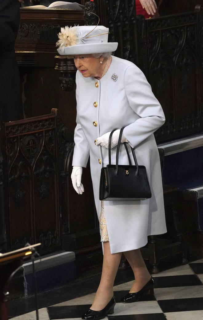 The Queen always favours a black handbag
