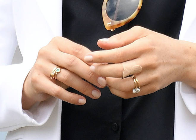 Meghan's stacked rings could signify an April due date
